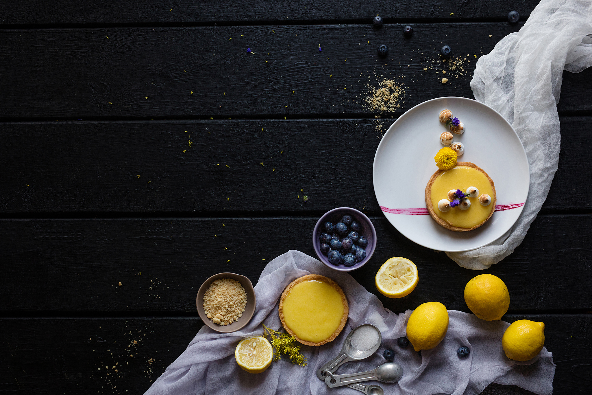 Food styling lemon tart with blueberries